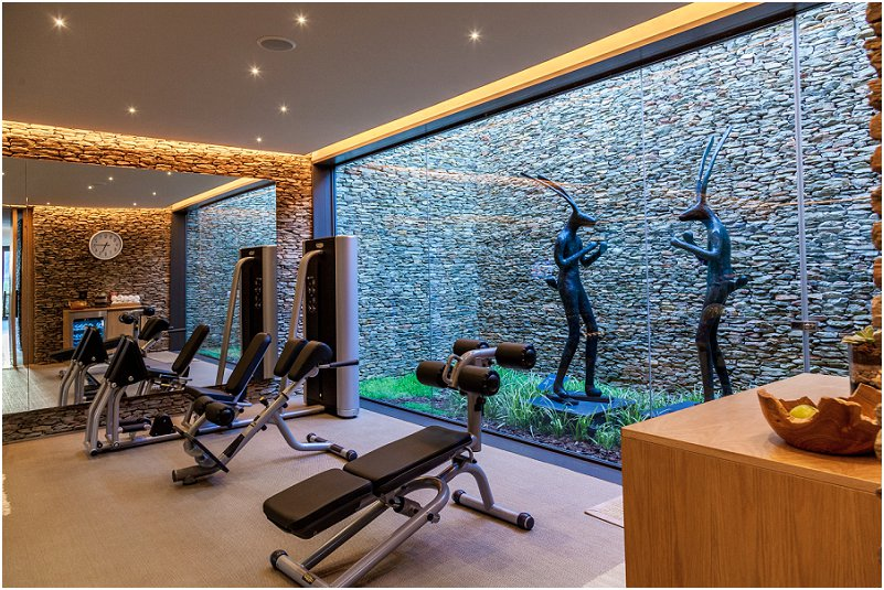 gym, two rabbits, statues, artwork, glass window, courtyard. leeu collection, vorsprung studio photography