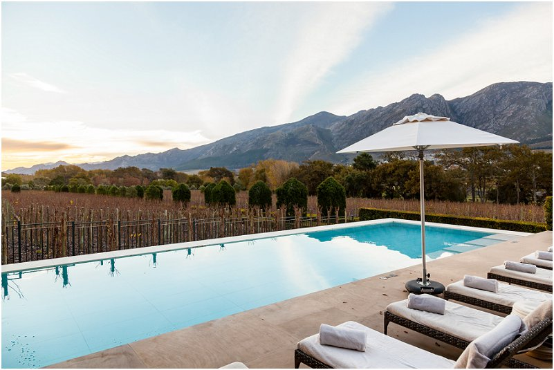 olympic pool, pool deck, umbrella, mountain, lounger, leeu collection, vorsprung studio photography