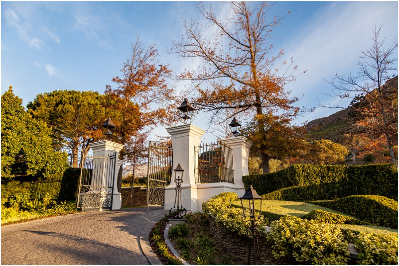 trees, blue skeis, formal garden, gates, walls, driveway, leeu collection, vorsprung studio photography