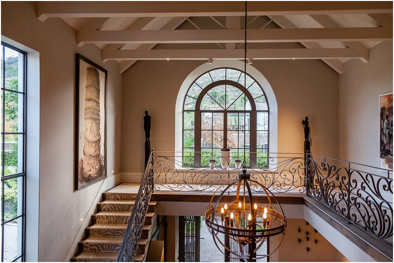 double volume entrance hall, art, stairs, artwork, windows, leeu collection, vorsprung studio photography