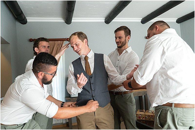 groom getting radey photos