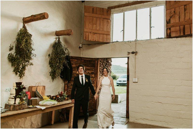 bridal couple entering the wedding venue