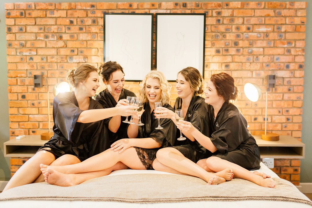 Bride & Bridesmaids drinking champagne