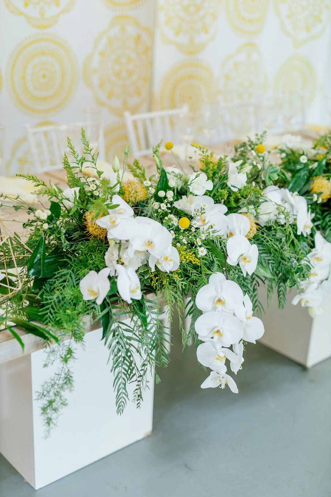 yellow and white wedding decor