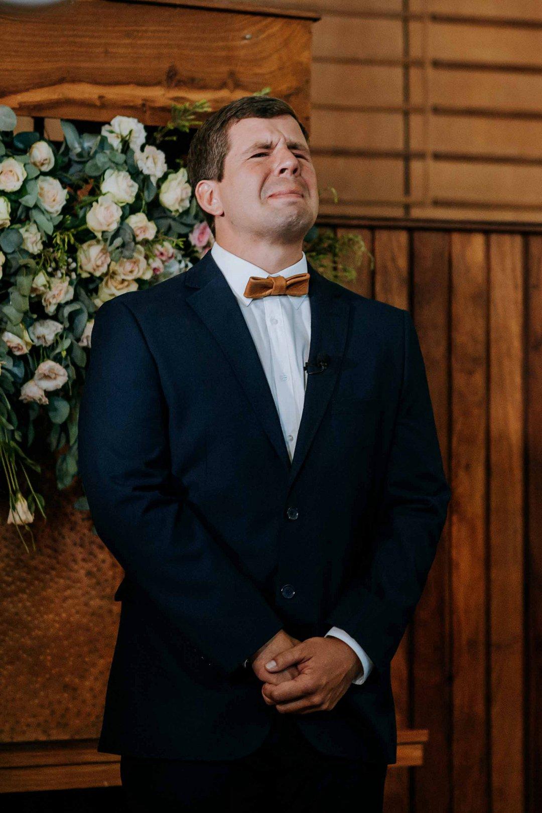 emotional groom at altar
